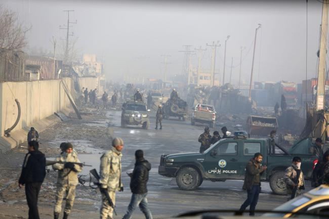 Afghan security forces gather at the site a day after an attack in Kabul, Afghanistan, in January (Picture: AP)