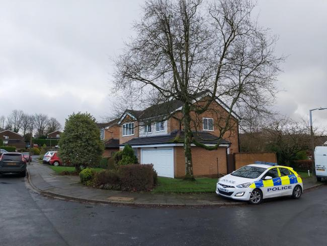 Police outside home of 85-year-old woman who was attacked and robbed by thugs at her house in Purbeck Drive, Horwich