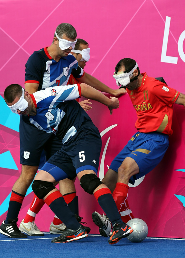 Great Britain's Daniel English (left) takes on Spain's Marcelo Rosado Carrasco (right) in the Men's Football 5-a-side Preliminary Round