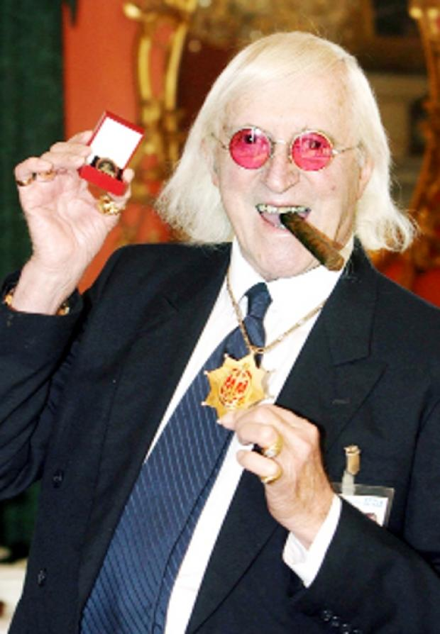 Lancaster And Morecambe Citizen: CIGAR MAN Flamboyant Jimmy Savile in 2008