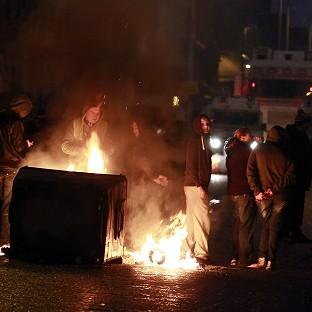 A burning barricade on the Newtownards road area of Belfast, where police were targeted by rioters