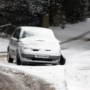 A car left in the snow near Bolney, West Sussex