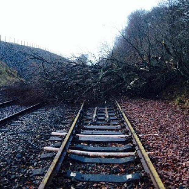 Lancaster And Morecambe Citizen: Road and rail travellers faced more misery as storms continue to batter Britain