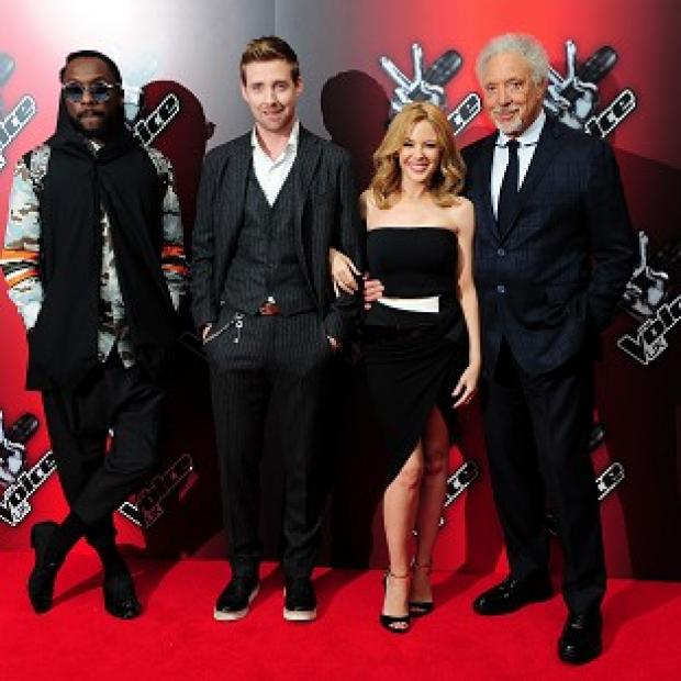 Lancaster And Morecambe Citizen: At the launch of BBC talent show The Voice are coahces (from left) Will.i.am, Ricky Wilson, Kylie Minogue and Sir Tom Jones