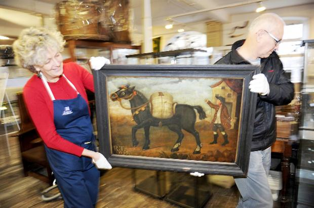 Lancaster And Morecambe Citizen: On the move: Museum curator Carol Davies and volunteer Tony Riley with the painting 'The Bell Mare'