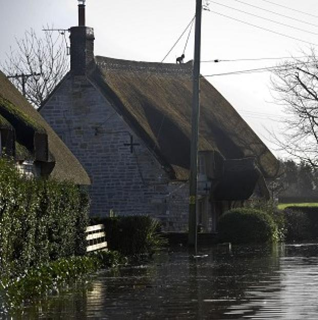Lancaster And Morecambe Citizen: Properties near the village of Muchelney, Somerset, where residents have been relying on volunteers in boats bringing in supplies