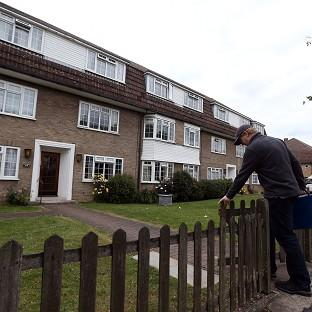 Lancaster And Morecambe Citizen: Police at flats in Bray Court in Chessington, Surrey where they arrested the brother of murdered British engineer Saad al-Hilli. Zaid al-Hilli has been released from police bail due to lack of evidence.