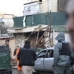 Lancaster And Morecambe Citizen: Afghan security forces investigate the suicide attack in Kabul, Afghanistan (AP)