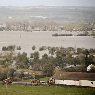 Lancaster And Morecambe Citizen: Flood water covers part of the Somerset Levels near Burrowbridge