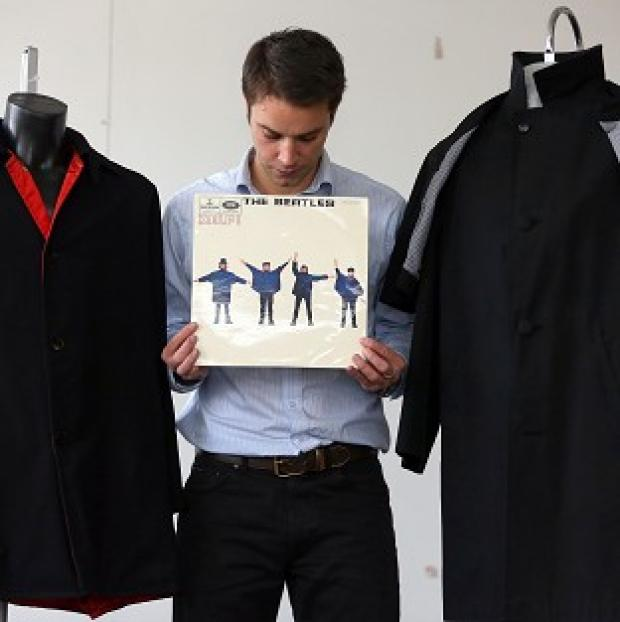 Lancaster And Morecambe Citizen: Auctioneer Paul Fairweather with jackets worn by George Harrison and Ringo Starr