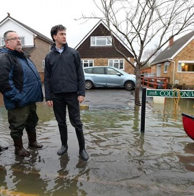 "Lancaster And Morecambe Citizen: Ed Miliband has attacked David Cameron for giving up the fight against climate change and said the winter storms should serve as a ""wake-up call"""