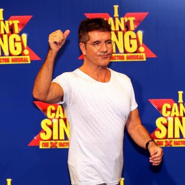 Lancaster And Morecambe Citizen: Simon Cowell at the launch of the X Factor Musical 'I Cant sing' which has been hit by a technical glitch