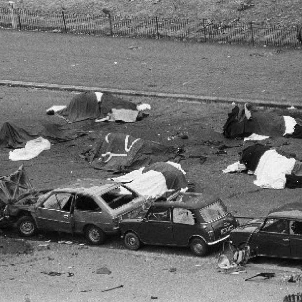 Lancaster And Morecambe Citizen: Dead horses and wrecked cars at the scene of an IRA bomb which exploded as the Household Cavalry was passing in Hyde Park, London, in 1982