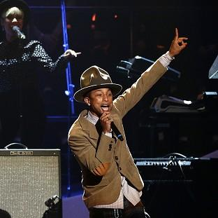 Lancaster And Morecambe Citizen: Pharrell Williams' hit Happy has hit the top of the singles chart for a third time - the first track to do this for 57 years