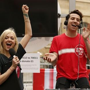 Lancaster And Morecambe Citizen: BBC Radio 1 breakfast show host Nick Grimshaw is joined by Fearne Cotton as he conducted his entire show from a bike as part of his Sport Relief challenge