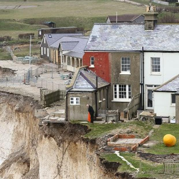 Lancaster And Morecambe Citizen: A resident of the cottage on the cliff edge at Birling Gap near Eastbourne