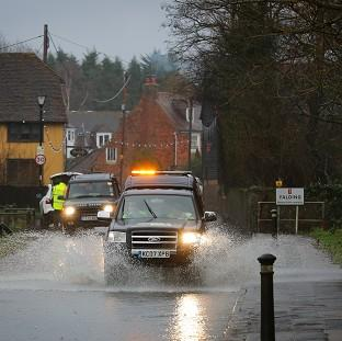 Lancaster And Morecambe Citizen: A car passes through a flooded road in Yalding, Kent