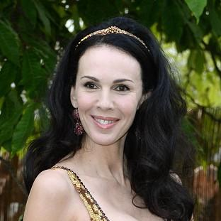 Lancaster And Morecambe Citizen: L'Wren Scott's body was discovered in her New York apartment, with a coroner ruling that she died after hanging herself