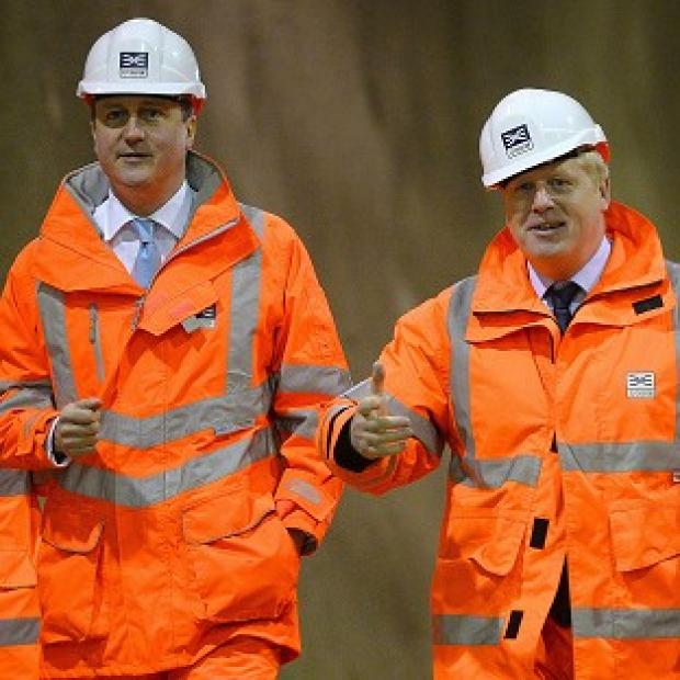 Lancaster And Morecambe Citizen: David Cameron (left) and Boris Johnson visiting a construction site. The PM wants the London Mayor to return to Parliament