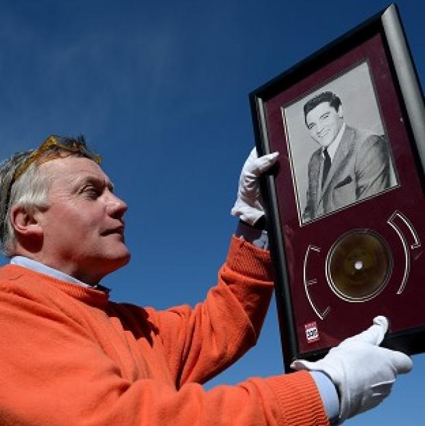 Lancaster And Morecambe Citizen: Jim Railton holds a rare strand of Elvis Presley's hair which will be sold at auction