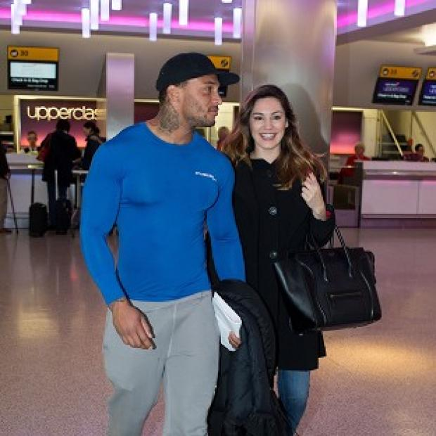 Lancaster And Morecambe Citizen: Kelly Brook with her reported fiance David McIntosh at Heathrow Airport