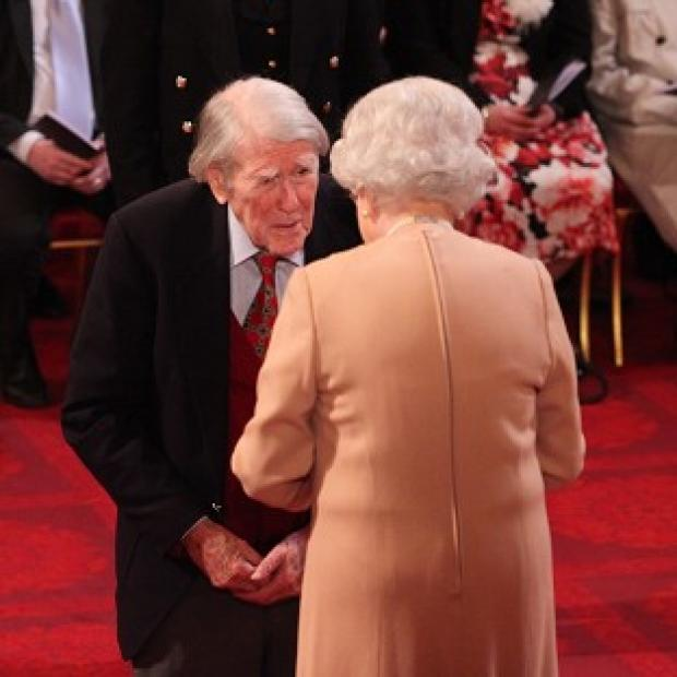 Lancaster And Morecambe Citizen: Raymond Roberts receives his Member of the British Empire medal from the Queen during an investiture ceremony at Buckingham Palace in February last year.