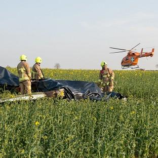 Lancaster And Morecambe Citizen: Emergency services at the scene of a plane crash in a field off the A414 near Ongar, Essex (PA/ Essex County Fire and Rescue Service)