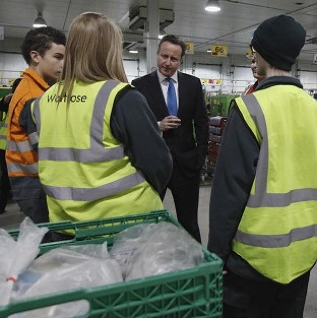 Lancaster And Morecambe Citizen: Prime Minister David Cameron speaking to apprentices at a Waitrose food distribution centre