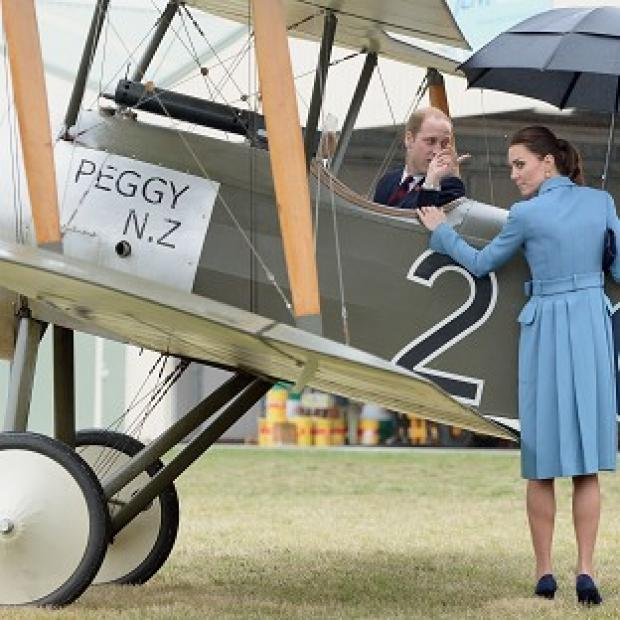 Lancaster And Morecambe Citizen: The Duchess of Cambridge looks on as the Duke of Cambridge climbs into the cockpit of a Sopwith Pup as they visit the Omaka Aviation Heritage Centre in Blenheim, during their official tour to New Zealand