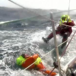 Lancaster And Morecambe Citizen: Andrew Taylor (left) being rescued by Jason Middleton after falling overboard during the Clipper Round the World Yacht Race (Clipper Ventures/PA)