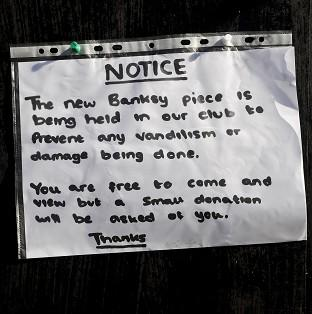 Lancaster And Morecambe Citizen: A notice sits where the latest officially confirmed Banksy artwork was, on Clements Street in Bristol