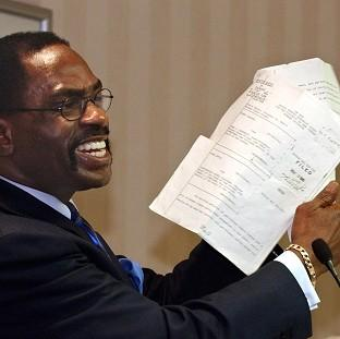 "Lancaster And Morecambe Citizen: Former boxer, Rubin ""Hurricane"" Carter,  holds up the writ of habeas corpus that freed him from prison"