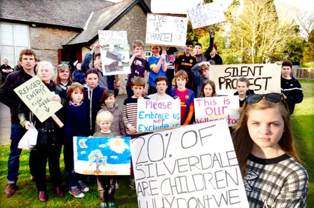 Lancaster And Morecambe Citizen: Youngsters with their signs and posters outside Silverdale Village Institute on the night of the meeting
