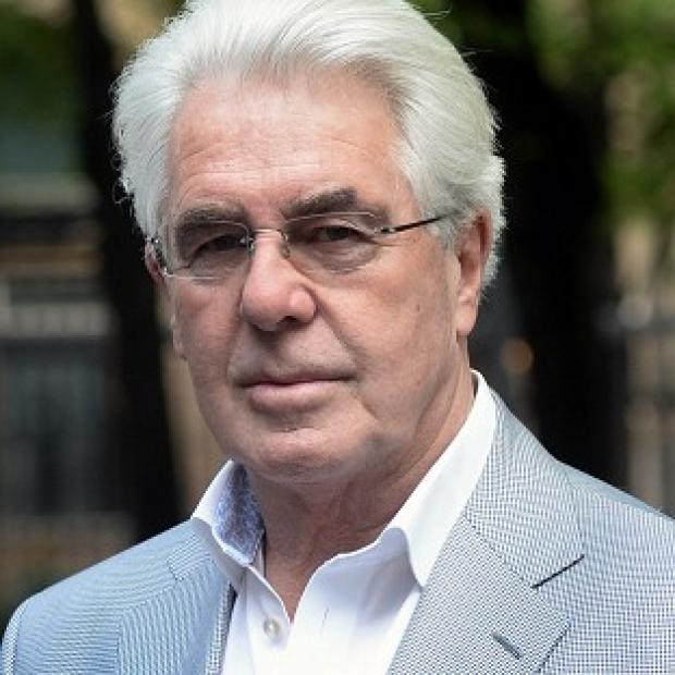 Lancaster And Morecambe Citizen: Publicist Max Clifford arrives at Southwark Crown Court in London