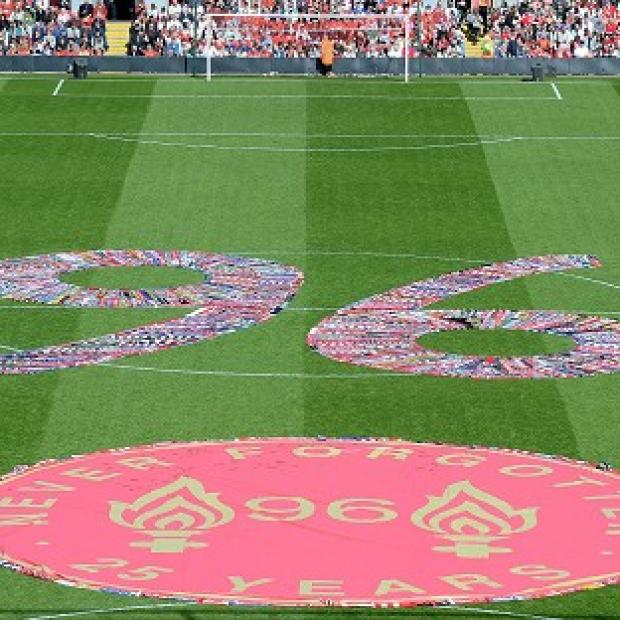 Lancaster And Morecambe Citizen: Fans' scarves make up a 96, filling the centre circle before the Hillsborough 25th Anniversary Memorial Service at Anfield Stadium, Liverpool