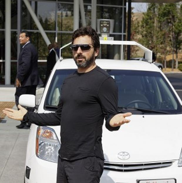 Lancaster And Morecambe Citizen: Google co-founder Sergey Brin with a driverless car in Mountain View, California