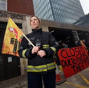Lancaster And Morecambe Citizen: Firefighter Jes Bate at Euston fire station in London as firefighters staged a five hour strike in a row over pensions