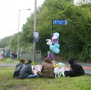 Lancaster And Morecambe Citizen: Friends of Jasmyn Chan hold a vigil near to the scene where the 14-year-old died following a hit-and-run collision in Sheffield