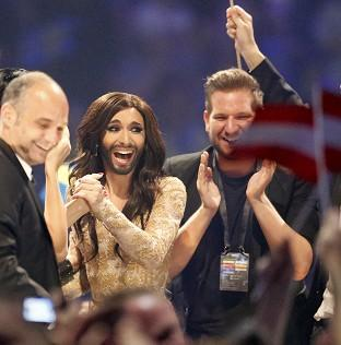 Lancaster And Morecambe Citizen: Austria's Conchita Wurst, who performed the song Rise Like a Phoenix, listens as points are announced at the final of the Eurovision Song Contest in Denmark (AP)