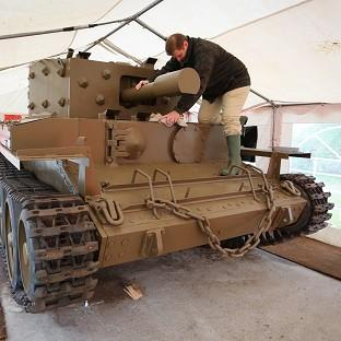 Lancaster And Morecambe Citizen: Nicolas Dumont works on a centaur tank which has been restored after lying abandoned on the banks of the Caen Canal near Pegasus Bridge since the Normandy Landings