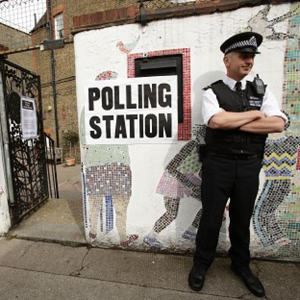 Lancaster And Morecambe Citizen: A police officer outside a polling station in Tower Hamlets