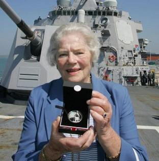 Lancaster And Morecambe Citizen: Lady Mary Soames, daughter of Sir Winston Churchill, has died aged 91. She is pictured holding a coin commemorating her father aboard the USS Winston S Churchill which was docked in Portsmouth.