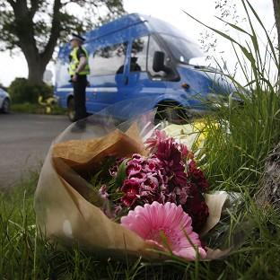 Lancaster And Morecambe Citizen: Floral tributes near the scene at Little Swinton, near Coldstream, where three people were killed after a car lost control at the Jim Clark Rally in the Scottish Borders yesterday.