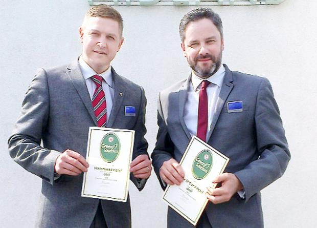 Lancaster And Morecambe Citizen: Mark Needham, left, from Waterhead, and Matt Stanaway, from The Midland, display their Gold Green Business Tourism Awards