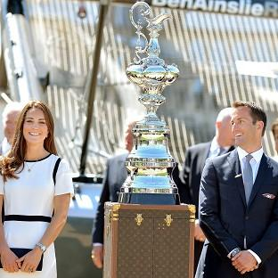 Lancaster And Morecambe Citizen: The Duchess of Cambridge with Sir Ben Ainslie in front of the America's Cup during a visit to the National Maritime Museum, London