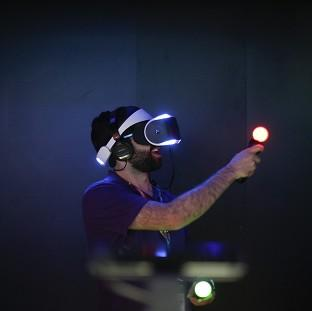 Lancaster And Morecambe Citizen: Jordan Saleh plays a video game with Sony's Project Morpheus virtual reality headset at the Electronic Entertainment Expo in Los Angeles. (AP Photo/Jae C. Hong)