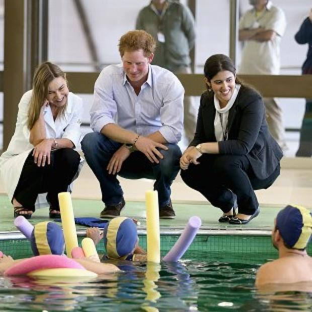 Lancaster And Morecambe Citizen: Prince Harry meets patients in the Rede Sarah Hospital for Nerological Rehabilitation injuries during his visit to the hospital in Brasilia