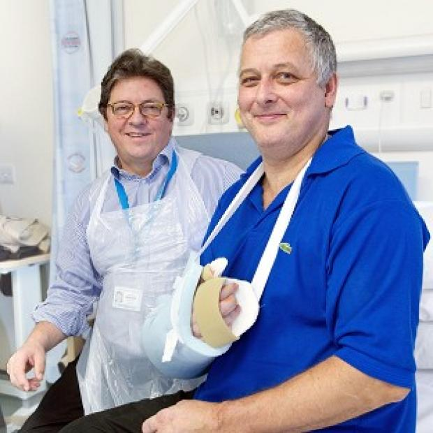 Lancaster And Morecambe Citizen: Professor Simon Kay (left) carried out the first hand transplant in the UK on Mark Cahill (right) last year (Leeds General Infirmary/PA)