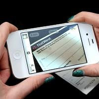 Lancaster And Morecambe Citizen: A smartphone user takes a photo of a cheque