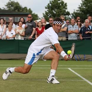 Lancaster And Morecambe Citizen: Pat Cash in action at Wimbledon in 2010 wearing his trademark headband